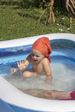 Kid in pool Stock Photography