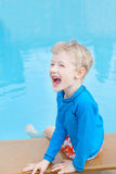 Kid by the pool Stock Photos