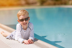Kid by the pool Royalty Free Stock Image