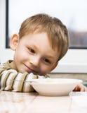 Kid and porridge Royalty Free Stock Photography