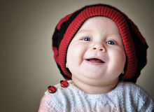 Kid portrait. Face portrait of smiling kid in red beret Stock Photos