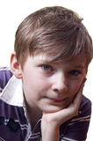 Kid portrait. A portrait of a kid holding his head left hand; isolated on the white background Stock Images