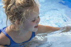 Kid portrait in pool Royalty Free Stock Photos