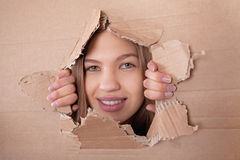 Kid portrait in torn paper hole Stock Photo