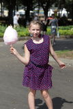 Kid poses with cotton candy Stock Images