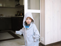 The kid poses in a jacket of the big size Stock Photos