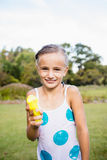 Kid posing at camera during a sunny day with her water gun Stock Images