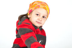 Kid posing in studio. Kid with funny bandanna posing in studio isolated on white background Royalty Free Stock Image