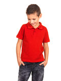 Kid posing at studio as a fashion model. Royalty Free Stock Image