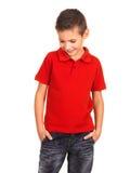 Kid posing at studio as a fashion model. Royalty Free Stock Image