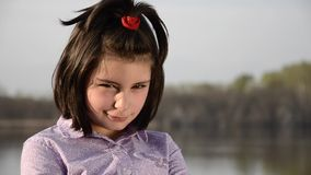 A kid pouts then smiles stock footage