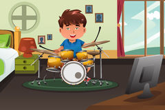 Kid practicing drum at home Royalty Free Stock Photography