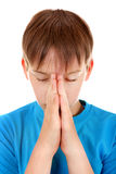 Kid praying. Isolated on the White Background royalty free stock images
