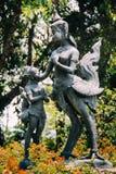 Kid Praying to Woman Statue looks alike Myth Giant Bird Royalty Free Stock Photos