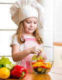 Kid preparing healthy food vegetable salad Stock Image