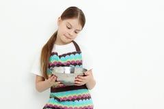 Kid preparing meal Royalty Free Stock Image