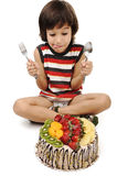 Kid preparing to eat the  cake Stock Photos