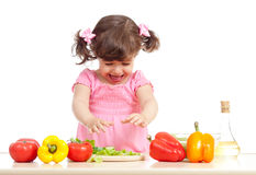 Kid preparing vegetable salad healthy food Stock Photo