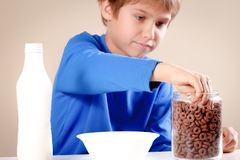 Kid prepating to eat breakfast. Selective focus.  Royalty Free Stock Photos