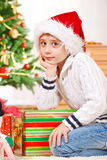 Kid  beside presents Stock Photo