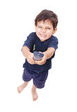 Kid is pressing remote control button. To change adult Royalty Free Stock Image