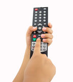 Kid pressing the remote control Royalty Free Stock Images