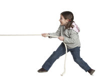 Kid pulling rope Stock Photo