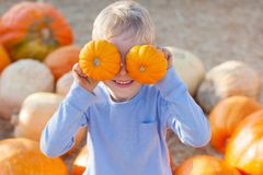 Kid at pumpkin patch Royalty Free Stock Images