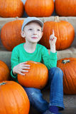 Kid at pumpkin patch Stock Images