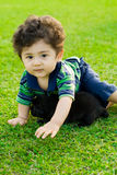 Kid and puppy Royalty Free Stock Photography