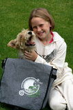 Kid and puppy playing with dreamstime bag Stock Photos