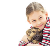 Kid with a puppy on a white background isolated Stock Images