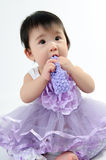 Kid in purple dress Royalty Free Stock Images