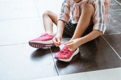 Kid Put Her Shoes By Herself Royalty Free Stock Photo