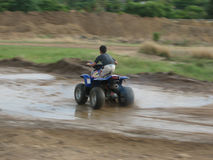 Kid on a Quad Bike Stock Images
