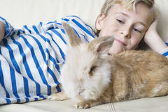 Kid with Rabbit at Home Royalty Free Stock Photos