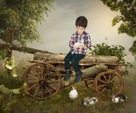 The Kid and rabbits Royalty Free Stock Photo
