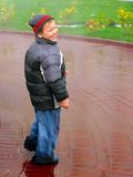Kid in the rain Royalty Free Stock Image