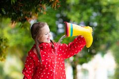 Kid with rain boots. Waterproof wear for children royalty free stock photos