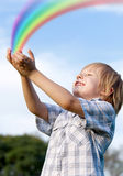 The kid and a rainbow Royalty Free Stock Photography