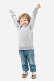 Kid raised his hands to the top Stock Image