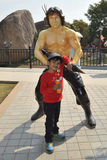 Kid with Rambo statue at Ramoji film city, hyderabad Stock Photos