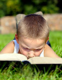 Kid read the Book Stock Photo