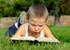 Kid read the Book outdoor Stock Photos