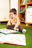 Kid reading Stock Photo