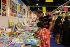 Kid reading at 8th KIBF Stock Photos