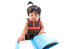 The kid reading a big book Royalty Free Stock Image