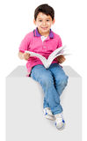 Kid reading a book Royalty Free Stock Photos