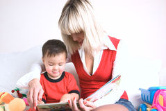Kid reading a book Royalty Free Stock Photo