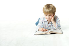 Kid Reading Book, Little Child Boy Read In School, Lying Down White Floor Royalty Free Stock Images